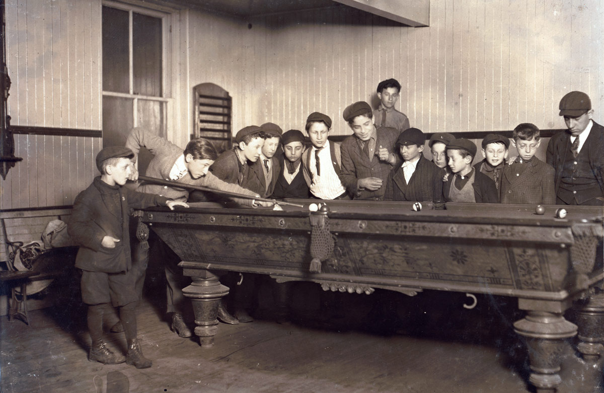 Boys play billiards in 1909